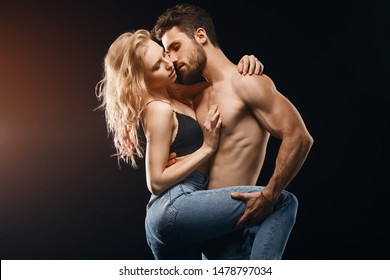 passionate man and woman having sex in the dark room. close up photo. isolated black background
