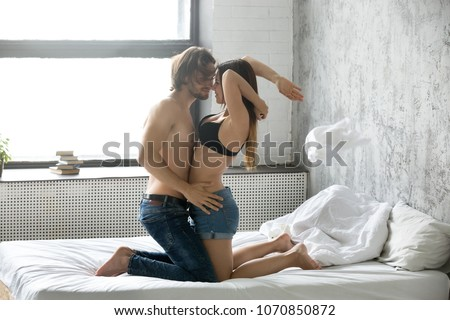 Sex couple undressing each other