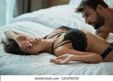 passionate sex- Young man and woman making love in bed