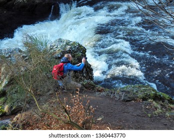 Passionate and waterfall.  Alyth, Blairgowrie, Scotland - February 15, 2019 An amateur photographer captures the beauty of nature at the Reekie Linn waterfall in Scotland.