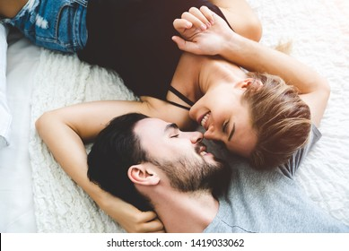 Passionate woman gently kissing man on with romantic kiss.desire lying on bed, young tender lover enjoys touching soft skin of sensual sexy lady moaning having sex.