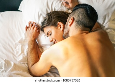 Passionate young couple having sex on the bed at home - Intimate and sensual moments of a couple making love in the bedroom - Adultery, intercourse, love, sexual concept
