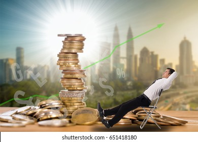 Passive income ,businessman sitting for wait money flow to his account.