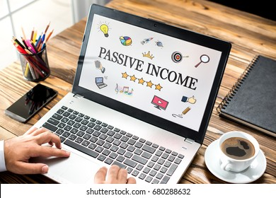 Passive Income Concept With Various Hand Drawn Doodle Icons On Laptop Monitor