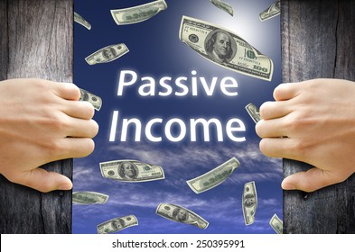 Passive Income and Financial Freedom Concept. Hand opening a wooden door and found a new world to success.
