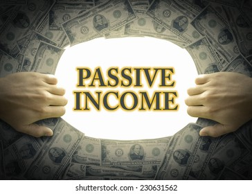 """""""Passive income"""" text on a white background behind hand opening the exit way from money banks."""