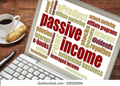passive income word cloud  on a laptop with a cup of coffee
