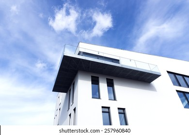 Passive modern building with a balcony on a sunny day