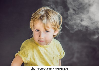 Passive smoking concept. The boy turns his face away from the cigarette smoke.