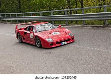 PASSO DELLA FUTA (FI), ITALY - MAY 18: a sports car Ferrari F40 runs in Ferrari Tribute to Mille Miglia, the historical italian race (1927-1957), on May 18, 2013 in Passo della Futa (FI) Italy