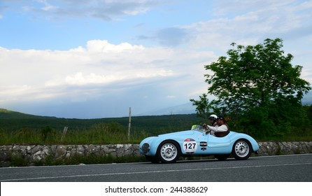 PASSO DELLA FUTA (FI), ITALY - MAY 17: A blue FIAT 500 A Sport takes part to the 1000 Miglia classic car race on May 17, 2014 near Passo della Futa (FI). The car was built in 1938