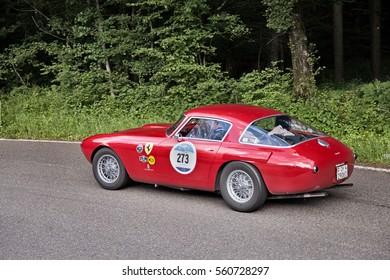 PASSO DELLA FUTA (FI), ITALY - MAY 21: crew on a vintage sportscar Ferrari 250 MM Berlinetta Pininfarina (1953) in italian classic car race Mille Miglia on May 21, 2016 in Passo della Futa (FI) Italy