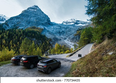 PASSO DELLO STELVIO, ITALY - OCTOBER 23, 2017: Jaguar F-Pace, Land Rover Discovery 5 and Range Rover Evoque made a long way to a mountain pass Stelvio located in northern Italy.