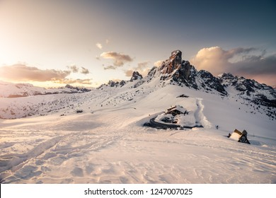 Passo Giau in Dolomites, part of Alps. Winter sunny photo Italy. Snow in mountains.
