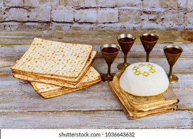 Passover background. wine and matzoh jewish holiday bread over wooden board.