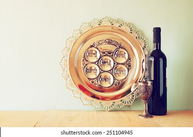 passover background. wine and matzoh (jewish holiday bread) over wooden background.