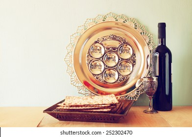 Passover background. wine and matzoh (jewish holiday bread) over wooden board.