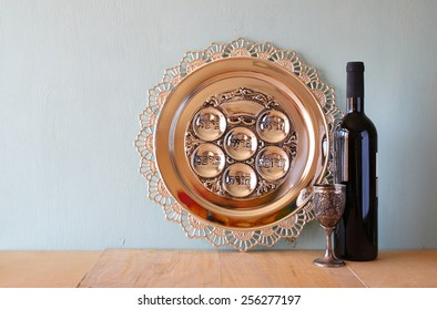 Passover background. wine and sedder plate