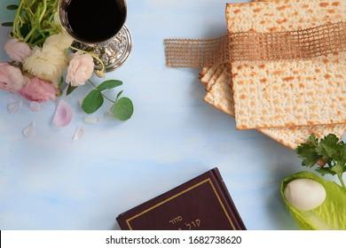 Passover celebration concept. Passover matzah isolated on blue wood background.