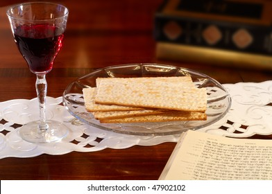 Passover elements of wine and matzoh on a table with Hebrew Old Testament open to the Passover passage in Exodus