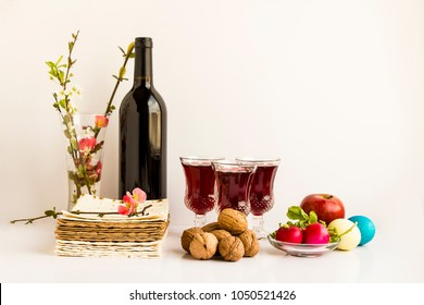Passover, the Feast of Unleavened Bread.Concept is Passover Holiday with symbolic foods and fresh spring flowers.White background,close up taken,isolated.