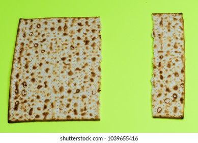 Passover Jewish holidays festive background.Two pieces of matzah on a yellow bright background with copy space or text space.