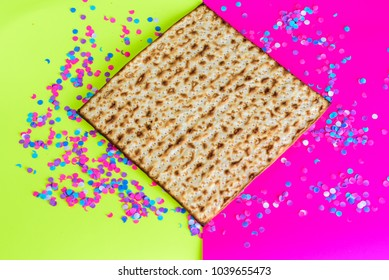 Passover Jewish holidays.Matzah and confetti on  bright celebrating background.Matza-Pesach symbol.