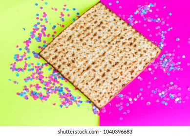 Passover Jewish holidays.Matzah and confetti on  bright celebrating background.Matzo-Pesach symbol.