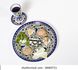 passover plate with cup of wine isolated on a white background