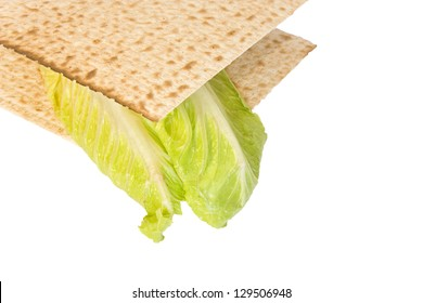 Passover seder matzo sandwich. Fresh Romaine lettuce leaves between two whole matzos for the seder ritual known as Korech. Close up profile, horizontal view. Isolated on a white background.