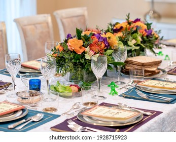 A Passover table setting with a floral centrepiece