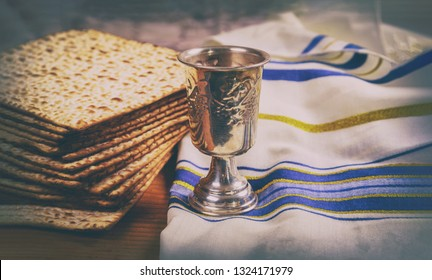 Passover wine and matzoh jewish holiday bread wooden board.