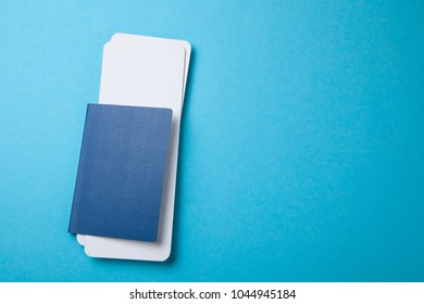Passport and air tickets on a blue background. mockup empty 	