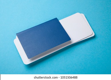 Passport and air tickets on a blue background. mockup empty blank