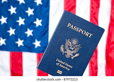A passport with the American flag in the background.