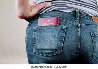 Passport in a back pocket of jeans
