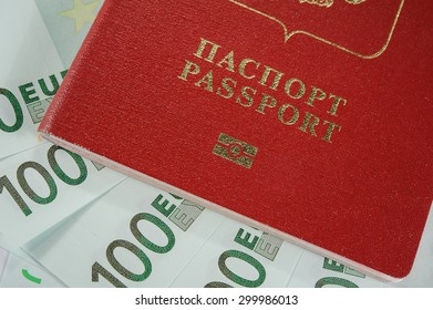 passport in the background of one hundred Euro banknotes in - time to travel