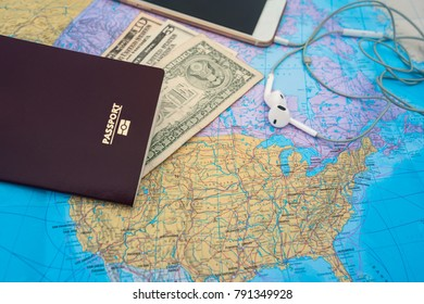 Passport with blank and smart phone and earphones on a world map background