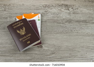 Passport and boarding pass on wooden background.