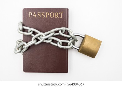 Passport with chain and padlock on white background, Illegal Immigration Concept