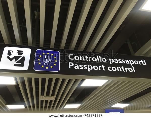 Passport control sign. Airport signs. European Union passport control. Departure and arrivals. Travel Italy. Italian border.