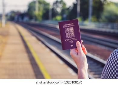 Passport of Czech Republic in female hand. Travel around the World
