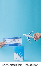 Passport, dollars and air ticket in woman hand on a pink background. Travel concept, copy space.