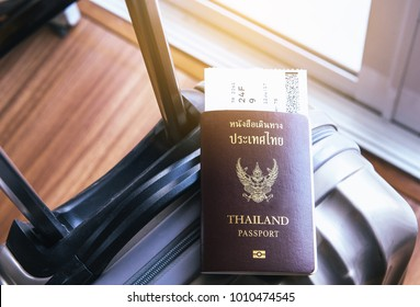 Passport with fight ticket on suitcase or luggage