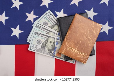 passport and money on the American flag