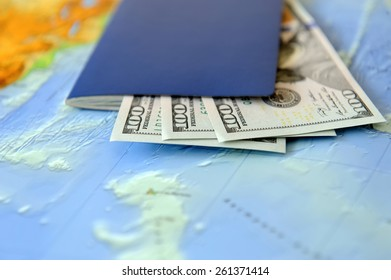 Passport and money on a background map of the world. Traveling concept
