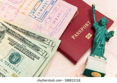 Passport, money and small statue of liberty
