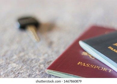 Passport on a desk with keys in the background. Travel Concept.