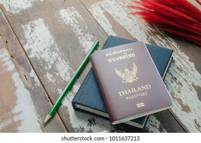 passport on wood table.