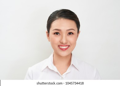 Passport photo. Portrait of asian smiling woman.